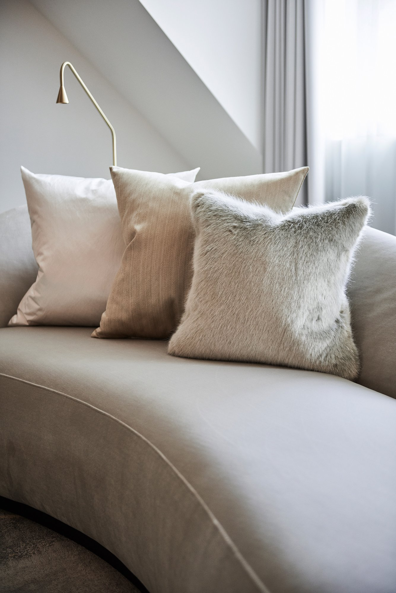 beige pillows fur on couch
