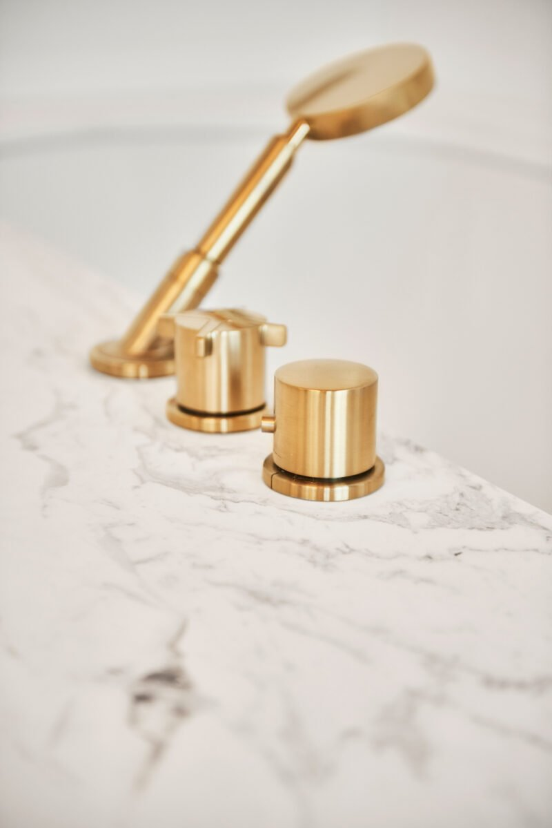 interior design bright bathroom marble white gold bath tap