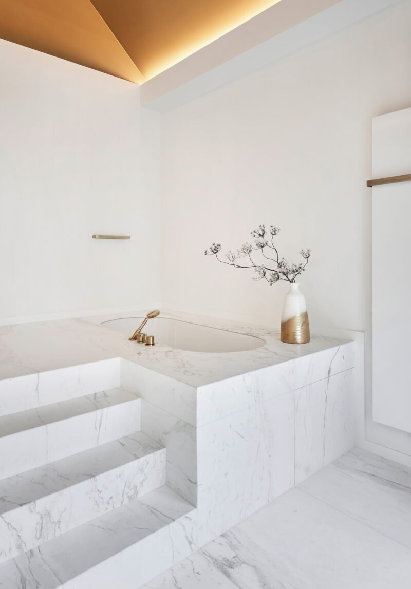 interior design bright bathroom marble white gold details