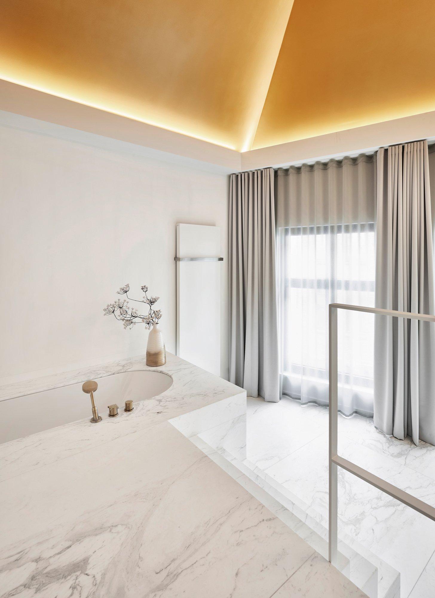 interior design bright bathroom marble white gold details