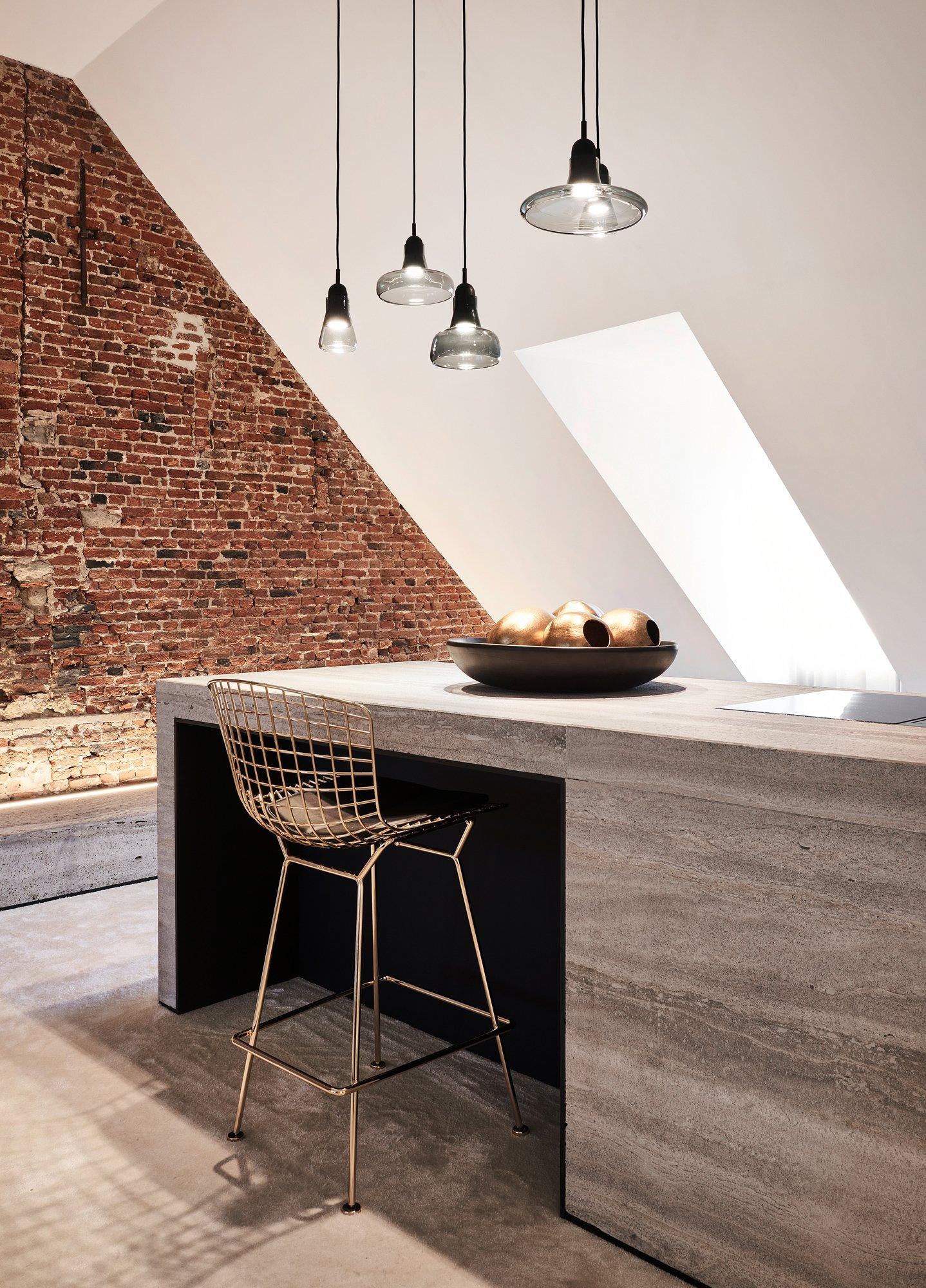 interior design multiple hanging lamps old brick details