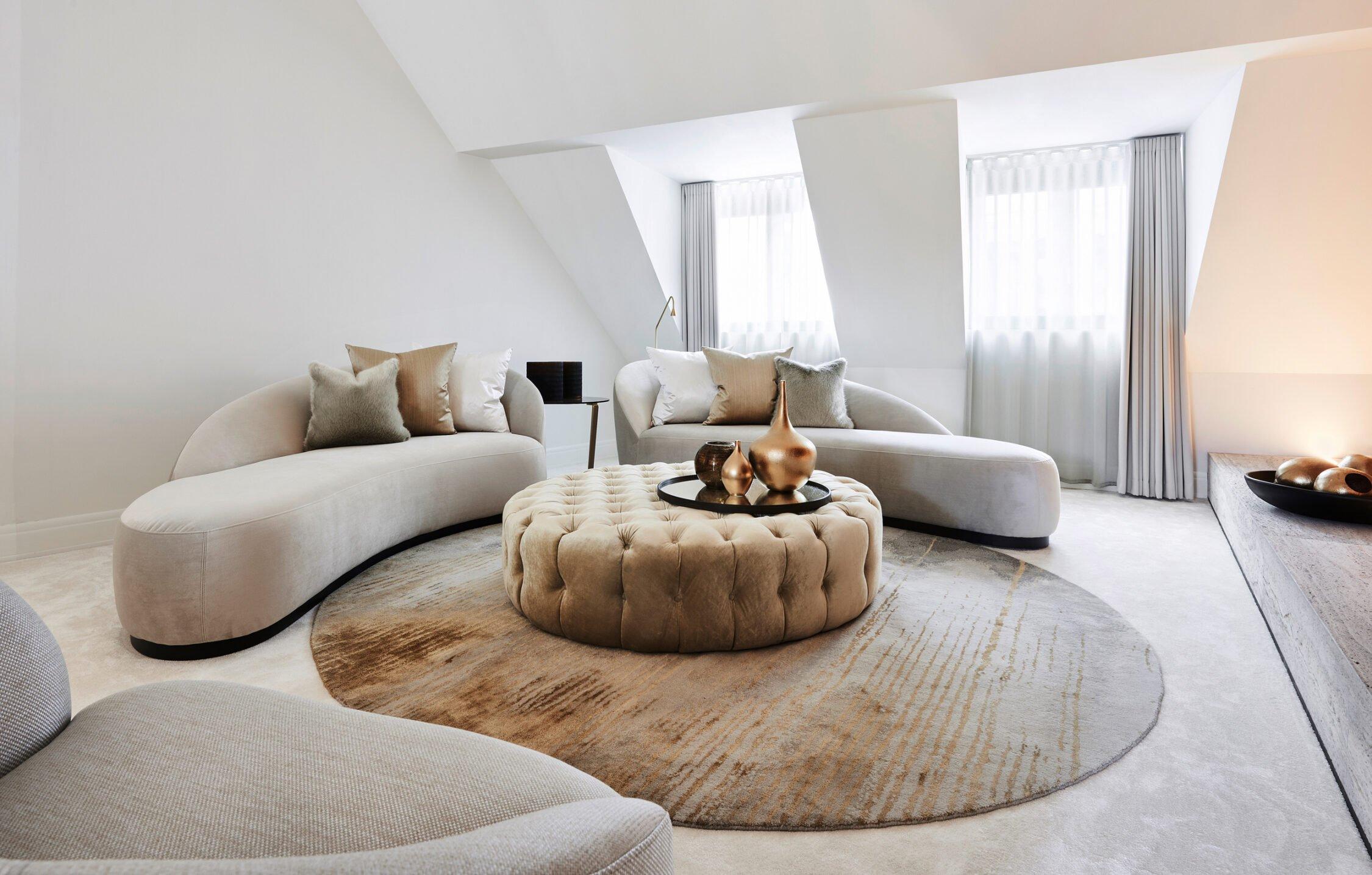 interior design beige couch gold details circle carpet