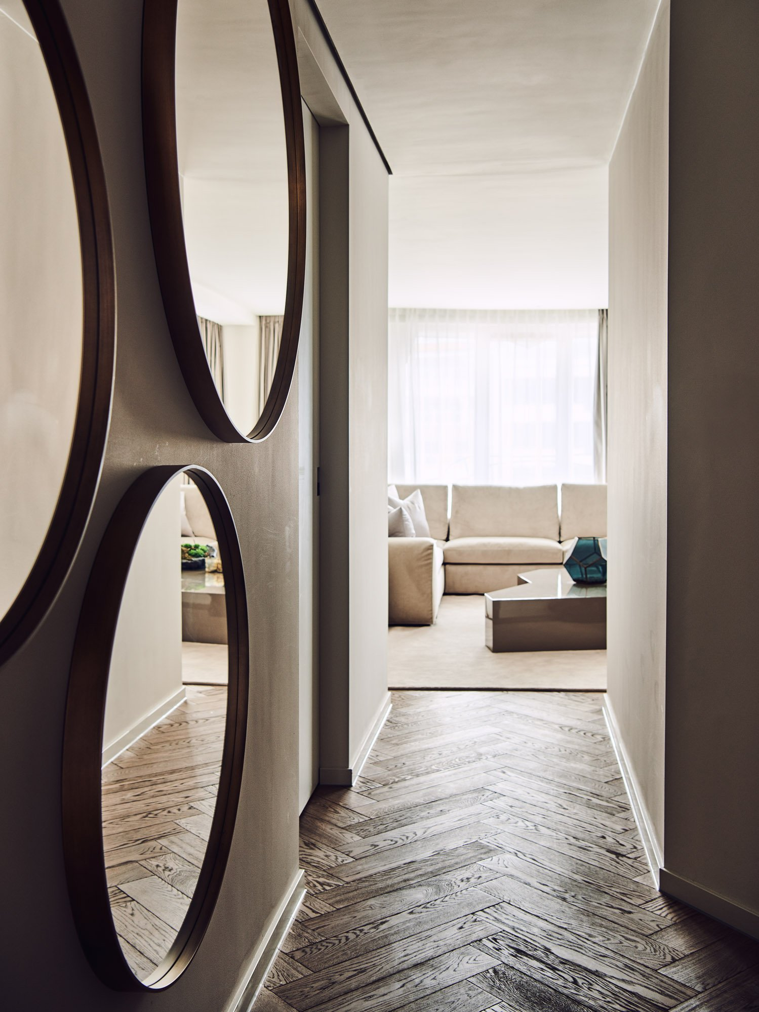 interior design beige brown large round mirrors in hallway